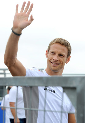 Jenson Button (Vodafone McLaren-Mercedes is waving) to the volks
