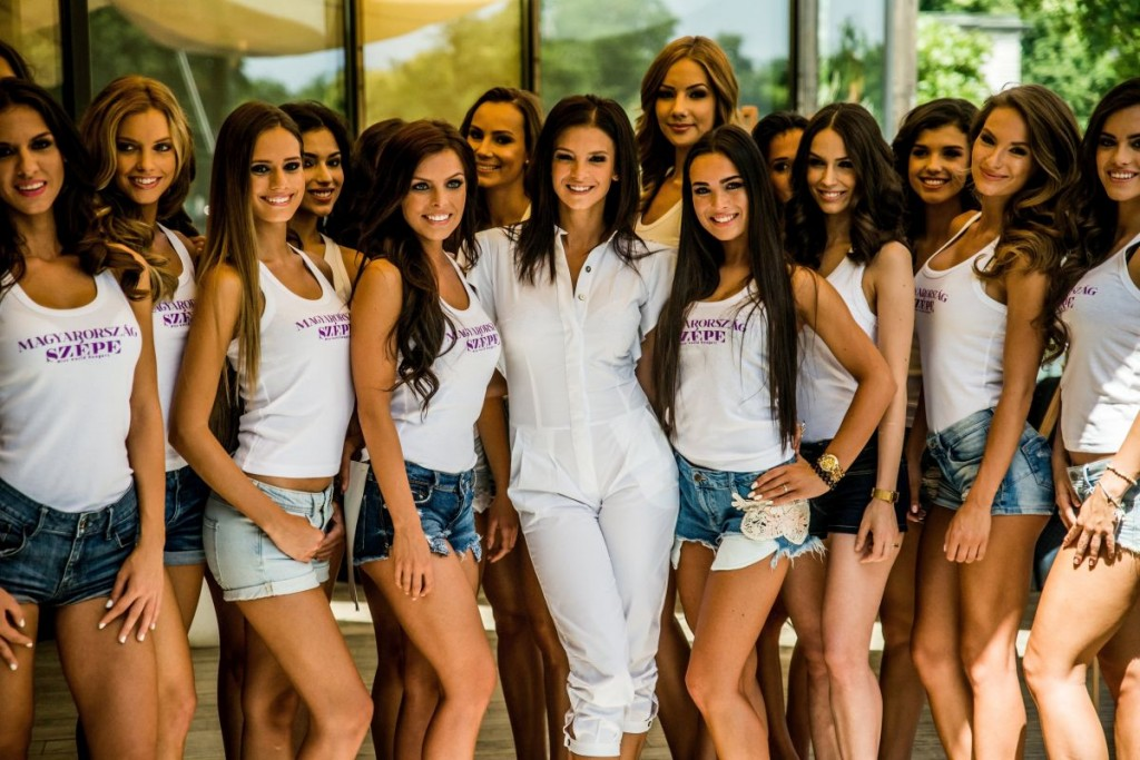 In the middle in white clothes there is Kata Sarka the managing director of the Hungarian Miss World. She also could enter the contest, couldn't she?